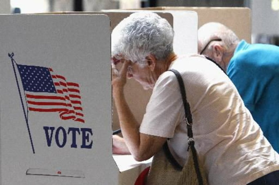 Photo - Betty and Dub Bagley vote today in Norman. Photo by Steve Sisney