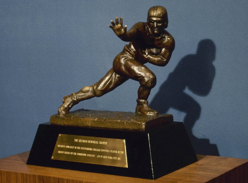 Photo - ** FILE ** The Heisman Trophy is shown in this 1978 photo file photo. The four Heisman finalists were announced Wednesday, Dec. 5, 2007. They are Hawaii quarterback Colt Brennan, Missouri quarterback Chase Daniel, Arkansas running back Darren McFadden and Florida quarterback Tim Tebow.   (AP Photo) ORG XMIT: NY176