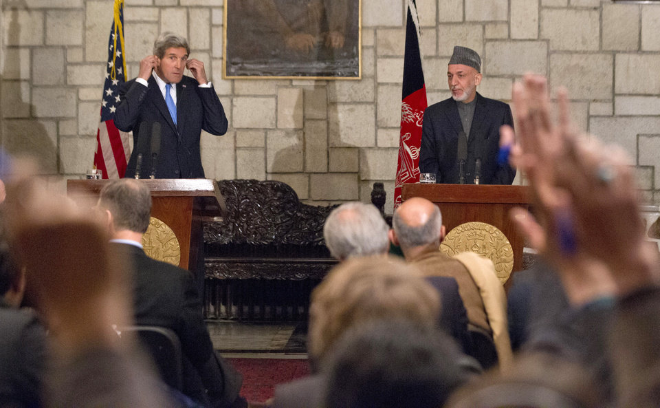 Photo - Secretary of State John Kerry and Afghan President Hamid Karzai take questions during their joint newss conference at the Presidential Palace in Kabul, Monday, March 25, 2013. Kerry and Karzai made a show of unity Monday, shortly after the U.S. military ceded control of its last detention facility in Afghanistan, ending a longstanding irritant in relations between the two countries. Kerry, in Afghanistan for an unannounced visit, said he and Karzai were