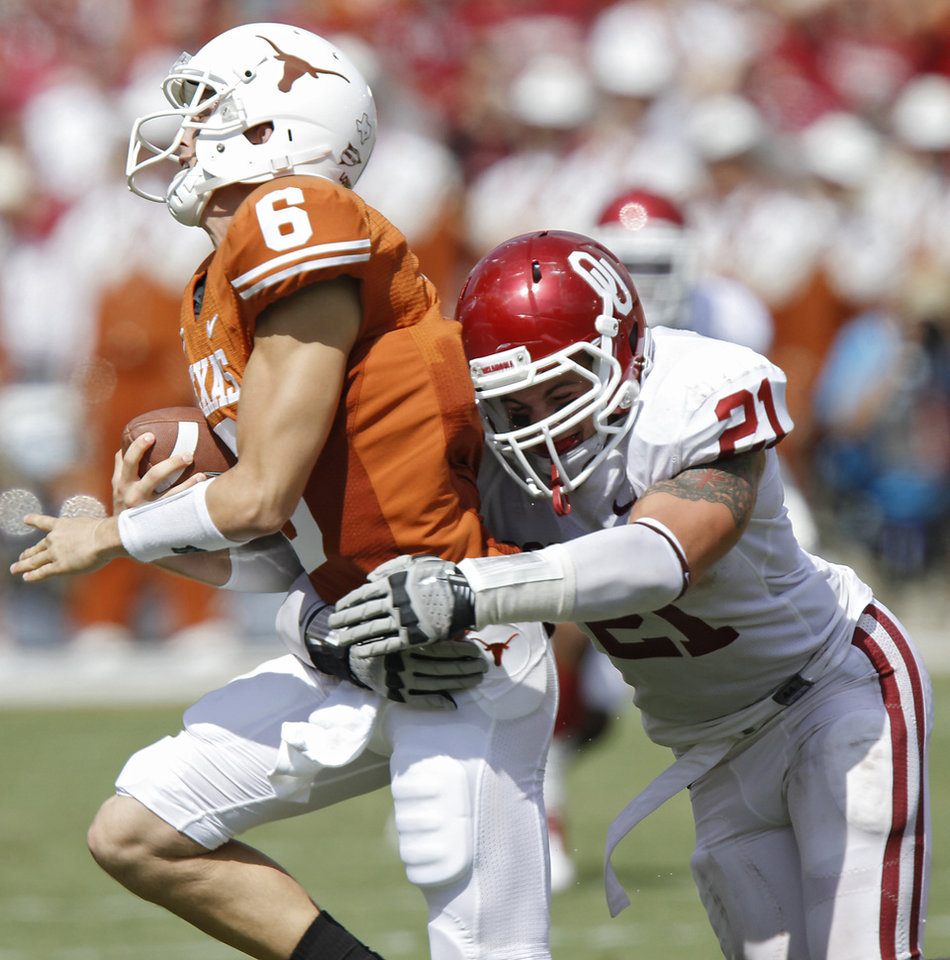 Oklahoma's Tom Wort (21) hits Texas quarterback Case McCoy (6) during the Red River Rivalry college football game between the University of Oklahoma Sooners (OU) and the University of Texas Longhorns (UT) at the Cotton Bowl in Dallas, Saturday, Oct. 8, 2011. Photo by Chris Landsberger, The Oklahoman