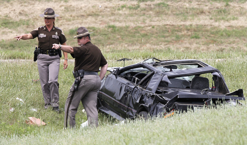 OHP / CAR ACCIDENT / WRECK / DEATH / INTERSTATE 40 / ROCKWELL AVENUE: The Oklahoma Highway Patrol investigates a single-car fatality accident which occurred on westbound I-40 at Rockwell Ave. in Oklahoma City, OK, Monday, May 14, 2012,  By Paul Hellstern, The Oklahoman