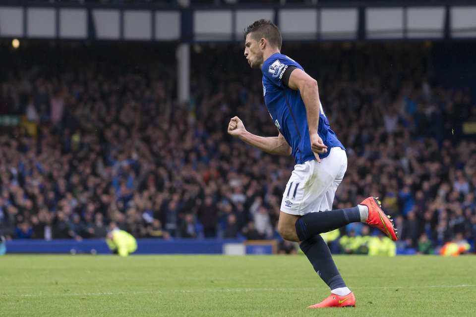 Photo - Everton's Kevin Mirallas celebrates after scoring against Chelsea during their English Premier League soccer match at Goodison Park Stadium, Liverpool, England, Saturday Aug. 30, 2014. (AP Photo/Jon Super)