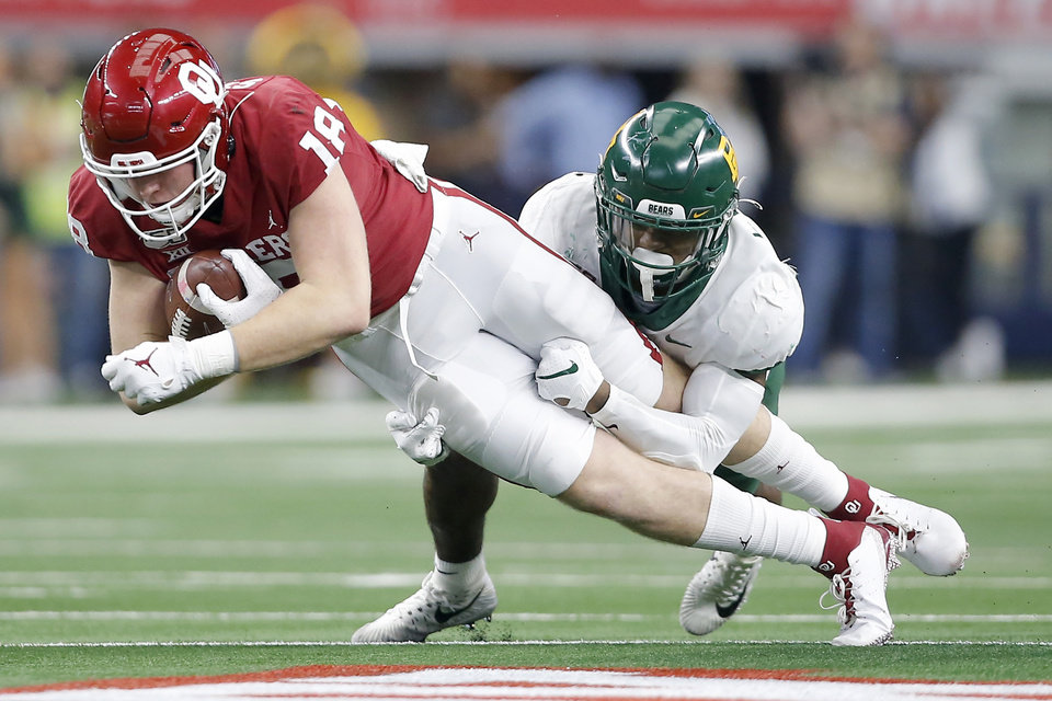 Photo - Oklahoma's Austin Stogner (18) is brought down by Baylor's Chris Miller (3) during the Big 12 Championship Game between the University of Oklahoma Sooners (OU) and the Baylor University Bears at AT&T Stadium in Arlington, Texas, Saturday, Dec. 7, 2019. Oklahoma won 30-23. [Bryan Terry/The Oklahoman]