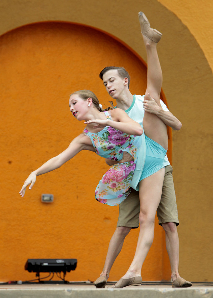 Photo - Savannah Gardner, 14 and Michael Tardibono, 16, from the Dove Dance Company dance at the Bandshell at the Oklahoma State Fair, Friday, September 13, 2013.  This was at 11:00 a.m. Photo by David McDaniel, The Oklahoman