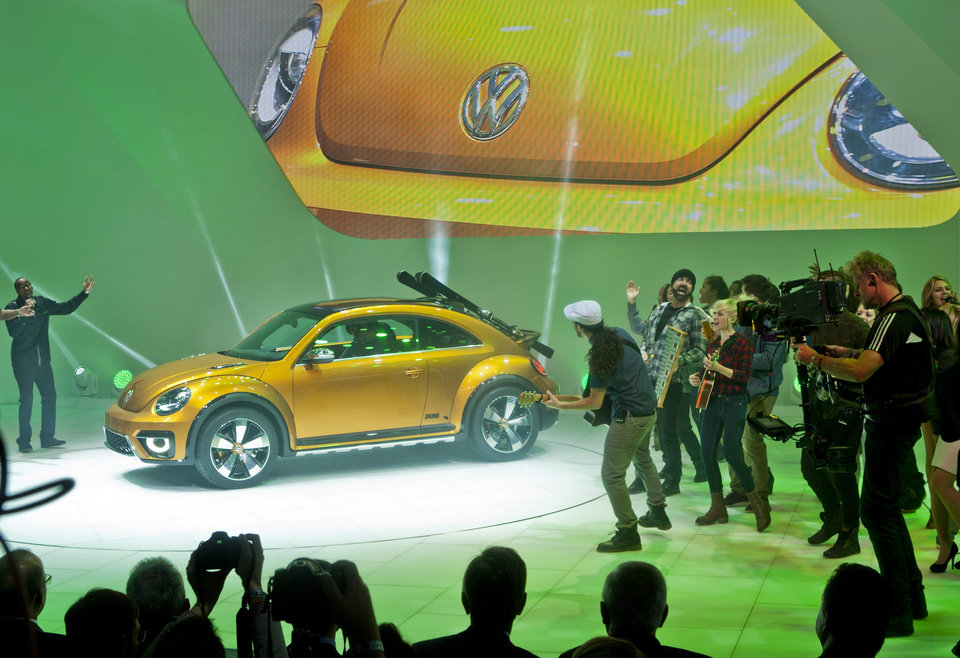 Photo - The Volkswagen Beetle Dune concept car is unveiled with performers, Monday, Jan. 13, 2014, at the North American International Auto Show in Detroit, Mich. (AP Photo/Tony Ding)