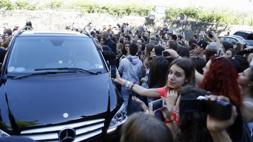 Photo - Fans crowd outside Forte Belvedere in Florence, Italy, Saturday, May 24, 2014. Kim Kardashian and Kanye West will wed and host a reception at Florence's imposing 16th-century Belvedere Fort on May 24, according to a spokeswoman at the Florence mayor's office. The couple rented the fort, located next to Florence's famed Boboli Gardens, for 300,000 euros ($410,000) and a Protestant minister will preside over the ceremony. Belvedere Fort was built in 1590, believed using plans by Don Giovanni de' Medici. Located near the Arno River, it offers a panoramic view of Florence and the surrounding Tuscan hills. (AP Photo/Gregorio Borgia)