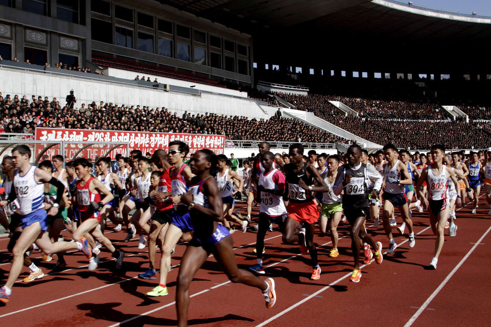 Photo - FILE - In this April 14, 2013 file photo, runners compete at the start of the 26th Mangyongdae Prize Marathon at Pyongyang's Kim Il Sung Stadium as North Korea hosts the sports event to mark the birthday of the late leader Kim Il Sung on April 15. For the first time ever, North Korea is opening up the streets of its capital to runner-tourists for the annual Pyongyang marathon, undoubtedly one of the most exotic feathers in any runner's cap. Tourism companies say they have been inundated by requests to sign up for the April 13, 2014 event, which this year will include amateur runners from around the world. (AP Photo/Jon Chol Jin, File)