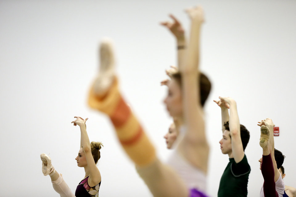 In this Wednesday, Feb. 27, 2013 photo, Pennsylvania Ballet's dancers perform exercises during a class at their new facility in Philadelphia. The company is celebrating its 50th birthday with a new facility and a season of performing brand new works and classic pieces. (AP Photo/Matt Rourke)