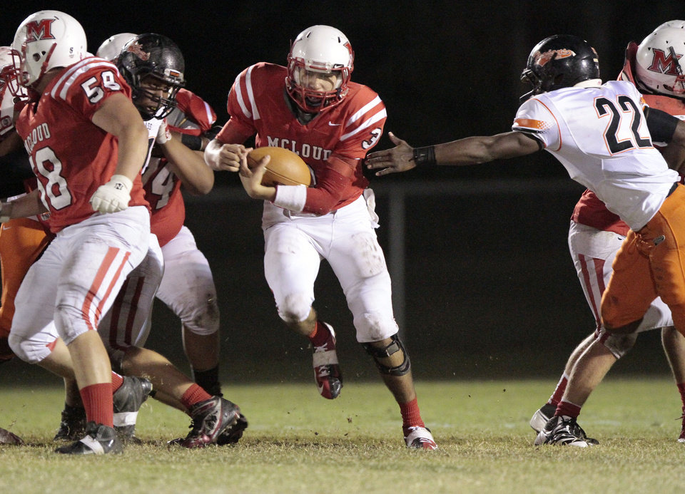 Photo - McLoud quarterback Joseph Wood carries against Douglass in high school football on Thursday, Oct. 18, 2012 in McLoud , Okla.  Photo by Steve Sisney, The Oklahoman
