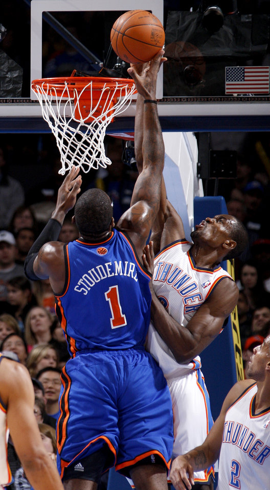 Photo - Oklahoma City's Serge Ibaka (9) blocks the shot of New York's Amare Stoudemire (1) during the NBA game between the Oklahoma City Thunder and the New York Knicks at Chesapeake Energy Arena in Oklahoma CIty, Saturday, Jan. 14, 2012. Photo by Bryan Terry, The Oklahoman