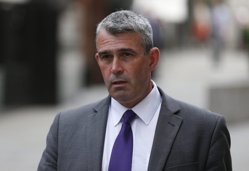 Photo - FILE - In this Tuesday, June 17, 2014 file photo, Mark Hanna, former head of security at News International, arrives at the Central Criminal Court in London where he will appear to face charges related to phone hacking. Former News of the World editor Andy Coulson was convicted of phone hacking Tuesday, June 24, 2014,  but fellow editor Rebekah Brooks was acquitted in the trial centering on illegal activity at the heart of Rupert Murdoch's newspaper empire. Three others — Brooks' husband Charles Brooks, her former secretary Cheryl Carter and News International security chief Mark Hanna — were acquitted of perverting the course of justice by attempting to hide evidence from police. Former News of the World managing editor Stuart Kuttner was found not guilty of phone hacking. (AP Photo/Sang Tan, File)