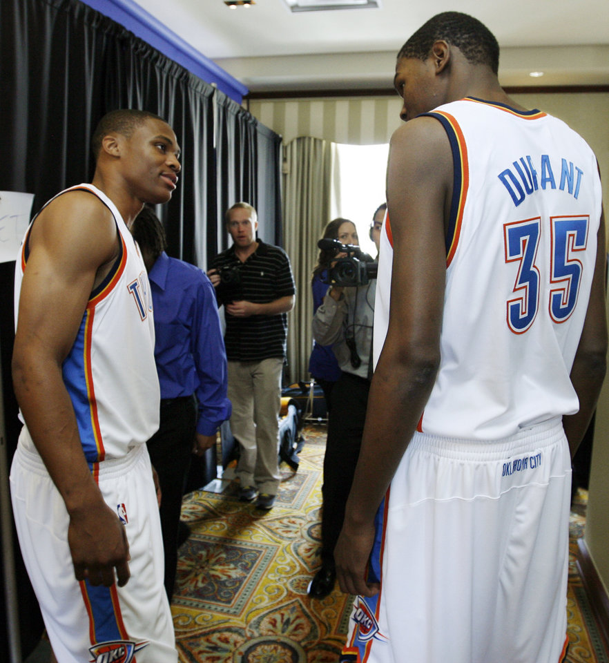 Photo - Russell Westbrook, left, and Kevin Durant talk between interviews during media day for the Oklahoma City Thunder NBA basketball team at the Skirvin Hilton hotel in Oklahoma City, Monday, September 29, 2008. BY NATE BILLINGS, THE OKLAHOMAN. ORG XMIT: KOD