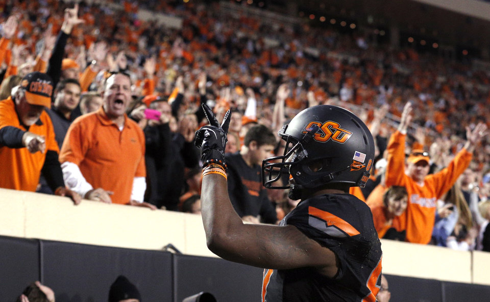 Photo - Oklahoma State's Tracy Moore (87) celebrates his touchdown pass during a college football game between the Oklahoma State University Cowboys (OSU) and the University of Kansas Jayhawks (KU) at Boone Pickens Stadium in Stillwater, Okla., Saturday, Nov. 9, 2013. Photo by Sarah Phipps, The Oklahoman