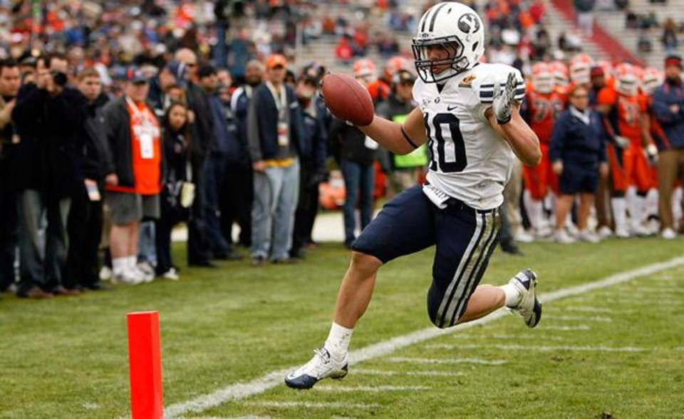 Photo - In this Dec. 18, 2010 photo, BYU running back JJ Di Luigi runs for a touchdown during an NCAA college football game against UTEP in the New Mexico Bowl in Albuquerque, N.M. (AP Photo/The Salt Lake Tribune, Trent Nelson)