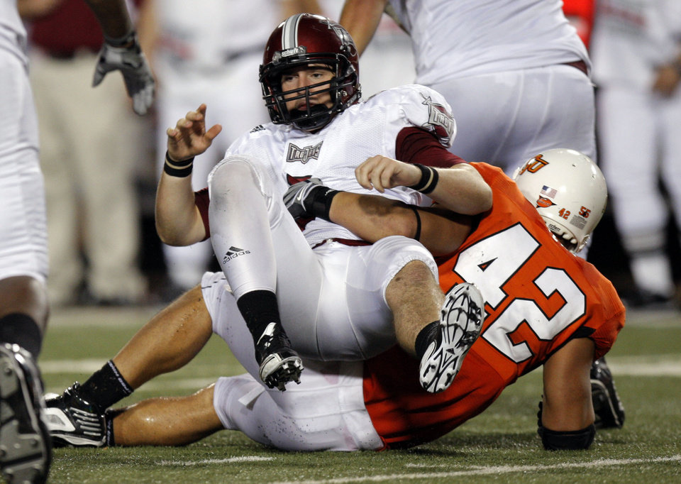 Troy's Corey Robinson (6) reacts after OSU's Justin Gent forces a fumble in the final minute during the college football game between the Oklahoma State University Cowboys (OSU) and the Troy University Trojans at Boone Pickens Stadium in Stillwater, Okla., Saturday, Sept. 11, 2010. Photo by Sarah Phipps, The Oklahoman