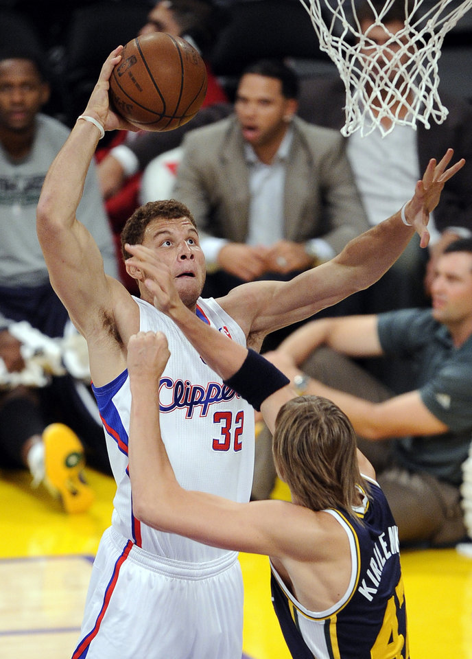 Photo - Los Angeles Clippers power forward Blake Griffin, left, goes up for a shot as Utah Jazz small forward Andrei Kirilenko defends during the first half of their preseason NBA basketball game, Saturday, Oct. 16, 2010, in Los Angeles. (AP Photo/Mark J. Terrill)
