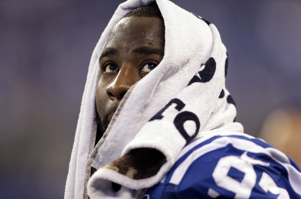 Photo - Indianapolis Colts's Aubrayo Franklin sits on the bench in the closing minutes of the second half of an NFL football game in Indianapolis, Sunday, Nov. 10, 2013. (AP Photo/Darron Cummings)