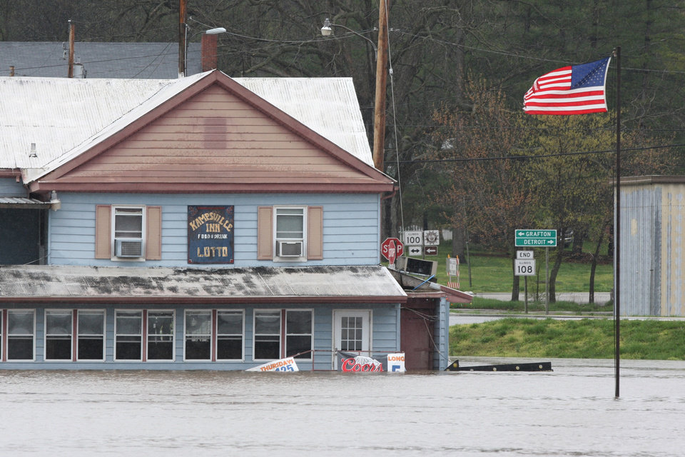 Illinois River floodwaters surround the Kamspville Inn in Kampsville, Ill., Tuesday April 23, 2013, as seen from the center of the river. The small Calhoun County, Ill., community is experiencing moderate flooding and the river is forecast to rise another 1.2 feet before cresting on Thursday. (AP Photo/The Telegraph, John Badman)