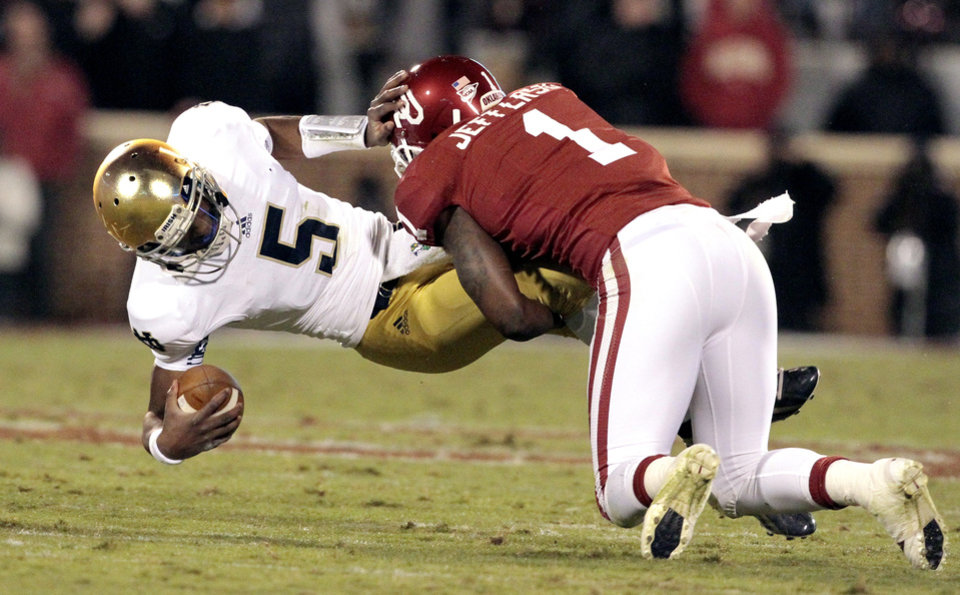 Photo - Oklahoma defensive back Tony Jefferson (1) tackles Notre Dame quarterback Everett Golson (5) and the ball comes lose during the second half of the college football game where the University of Oklahoma Sooners (OU) were defeated by the Fighting Irish of Notre Dame (ND) 30-13 at Gaylord Family-Oklahoma Memorial Stadium in Norman, Okla., on Saturday, Oct. 27, 2012. The player was ruled down.  Photo by Steve Sisney, The Oklahoman