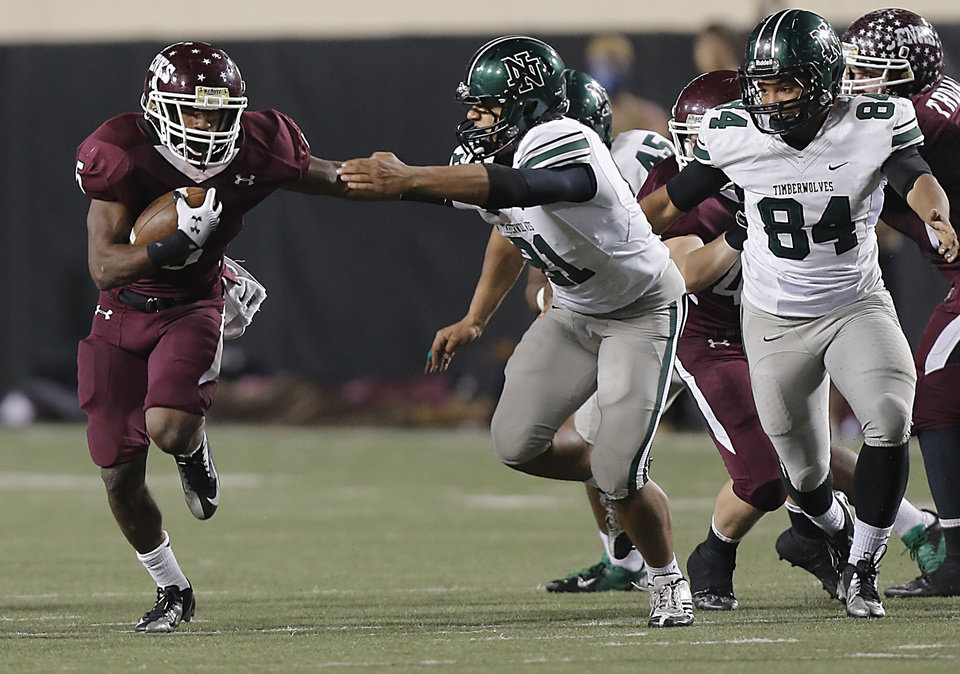 Photo - Jenks' Trey'Vonne Barr'e (5) runs past Norman North's D.J. Hicks (21) during the Class 6A Oklahoma state championship football game between Norman North High School and Jenks High School at Boone Pickens Stadium on Friday, Nov. 30, 2012, in Stillwater, Okla.   Photo by Chris Landsberger, The Oklahoman