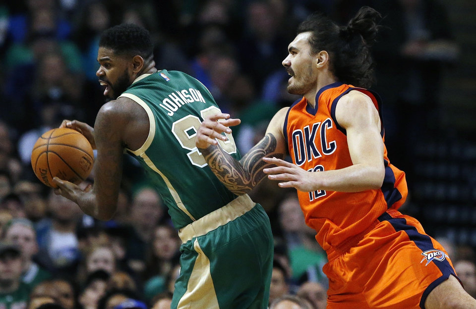 Photo - Boston Celtics' Amir Johnson (90) grabs a loose ball in front of Oklahoma City Thunder's Steven Adams (12) during the second quarter of an NBA basketball game in Boston, Wednesday, March 16, 2016. (AP Photo/Michael Dwyer)