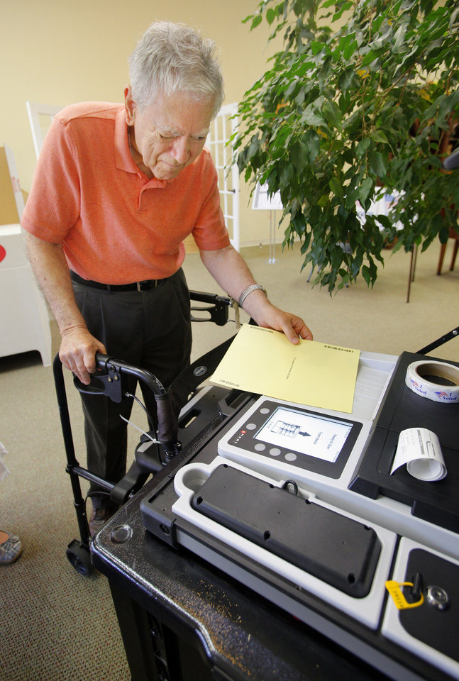 John Boaz, Edmond, putting his ballot in the voting machine at precinct 47 in Edmond Tuesday, June 26, 2012.   Photo by Paul B. Southerland, The Oklahoman