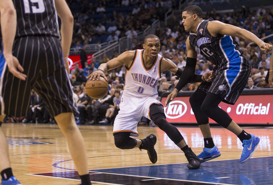 Oklahoma City Thunder\'s Russell Westbrook (0) dribbles up the middle of the key while defended by Orlando Magic\'s Tobias Harris (12) during the second half of an NBA basketball game on Friday, March 22, 2013, in Orlando, Fla. The Oklahoma City Thunder won 97-89. (AP Photo/Willie J. Allen Jr.) ORG XMIT: FLWA108