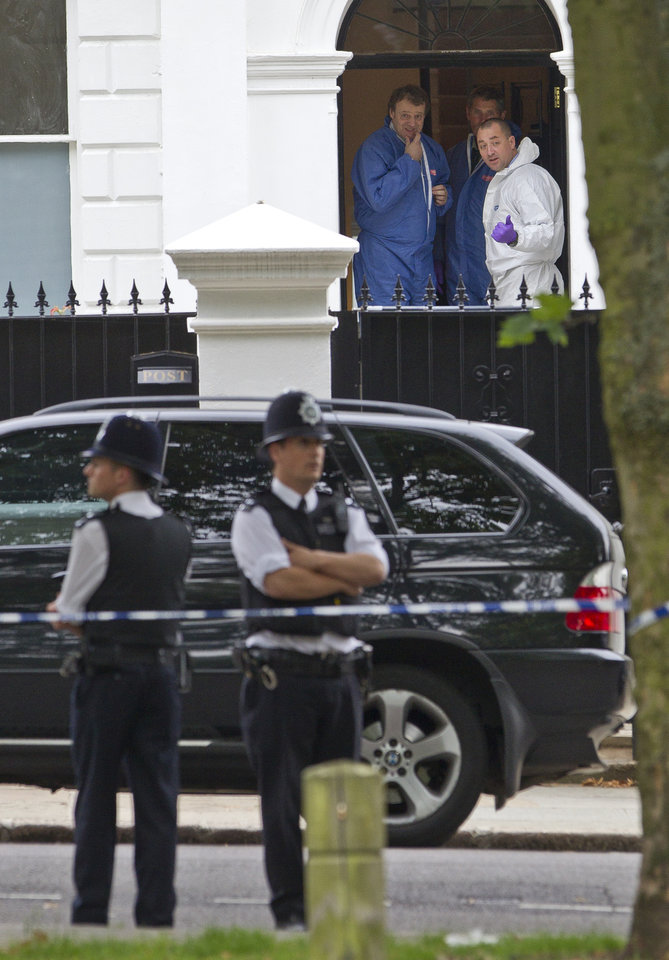 Photo - A police forensic team leave the home of British singer Amy Winehouse in Camden Square, London, following her death, Saturday, July 23, 2011.  The cause of death was not immediately known, and London Ambulance Services said Winehouse had died before the two ambulance crews arrived at the scene. (AP Photo/Joel Ryan) ORG XMIT: LENT103