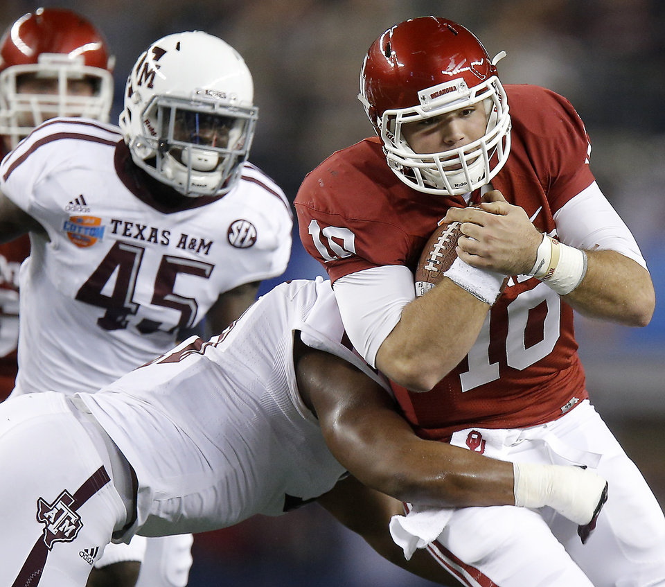 Oklahoma's Blake Bell (10) tries to get past Texas A&M 's Jonathan Stewart (11) during the Cotton Bowl college football game between the University of Oklahoma (OU)and Texas A&M University at Cowboys Stadium in Arlington, Texas, Friday, Jan. 4, 2013. Photo by Bryan Terry, The Oklahoman