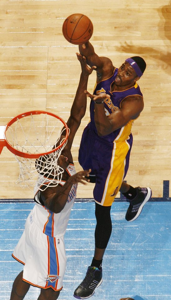 Los Angeles' Dwight Howard (12) shoots against Oklahoma City's Serge Ibaka (9) during an NBA basketball game between the Oklahoma City Thunder and the Los Angeles Lakers at Chesapeake Energy Arena in Oklahoma City, Friday, Dec. 7, 2012. Oklahoma City won, 114-108. Photo by Nate Billings, The Oklahoman