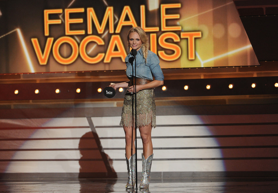 Photo - Miranda Lambert accepts the award for female vocalist of the year at the 49th annual Academy of Country Music Awards at the MGM Grand Garden Arena on Sunday, April 6, 2014, in Las Vegas. (Photo by Chris Pizzello/Invision/AP)
