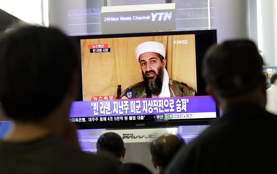 Photo - South Koreans watch a TV broadcasting a report about Osama bin Laden, at Seoul train station in Seoul, South Korea, Monday, May 2, 2011. Bin Laden, the glowering mastermind behind the Sept. 11, 2001, terror attacks that murdered thousands of Americans, was killed in an operation led by the United States, President Barack Obama said Sunday. The Korean read