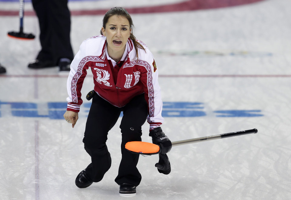 Photo - Russia's skip Anna Sidorova shouts instructions after delivering the rock during women's curling competition against Britain at the 2014 Winter Olympics, Monday, Feb. 17, 2014, in Sochi, Russia. (AP Photo/Robert F. Bukaty)