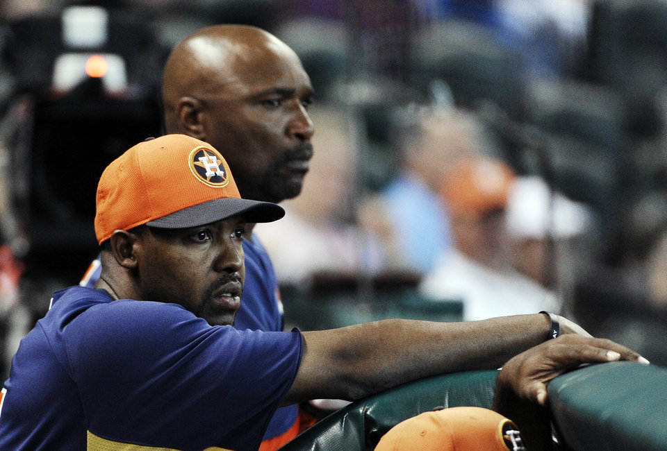 Houston Astros manager Bo Porter, left, and first base coach Dave Clark watch the third inning of an exhibition baseball game against the Chicago Cubs, Saturday, March 30, 2013, in Houston. (AP Photo/Pat Sullivan)