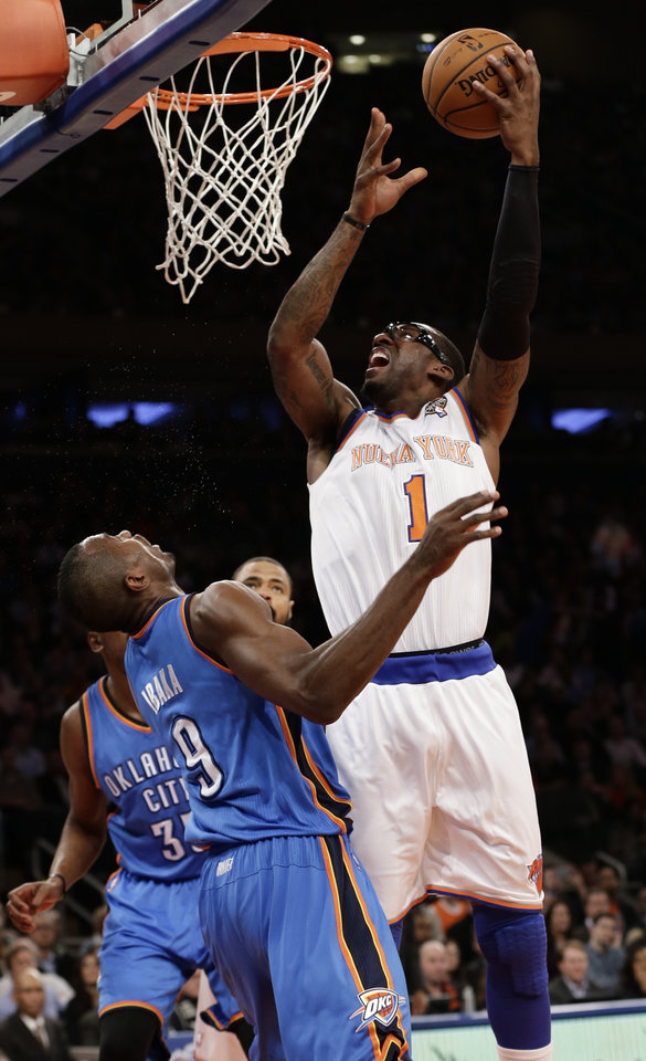 Photo - New York Knicks' Amare Stoudemire (1) shoots over Oklahoma City Thunder's Serge Ibaka (9) during the first half of an NBA basketball game Thursday, March 7, 2013, in New York. (AP Photo/Frank Franklin II)