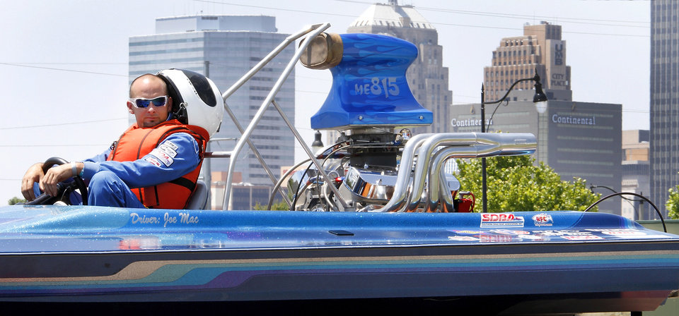 Joe McIntyre waits to take a test run during the Oklahoma City Nationals professional drag boat racing on the Oklahoma River in Oklahoma City, Thursday, June 8, 2012. Photo By Steve Gooch, The Oklahoman