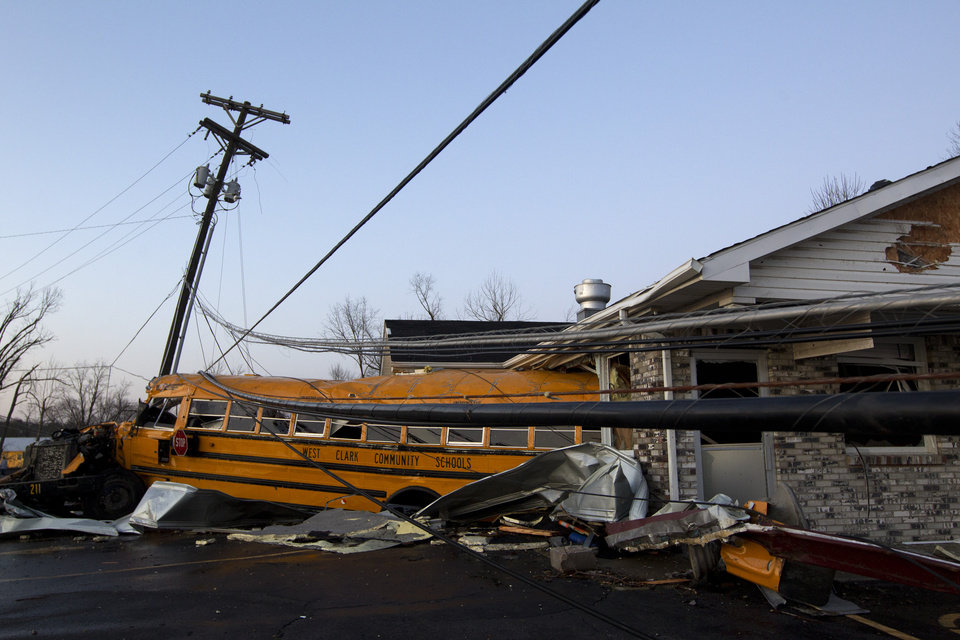A school bus is pushed through the front of a building after a tornado swept through Henryville, Ind., Friday March 2, 2012.  The storm was part of a system that brought high winds and heavy rain to parts of Indiana, Kentucky and Tennessee.  (AP Photo/Philip Scott Andrews) ORG XMIT: INPA103