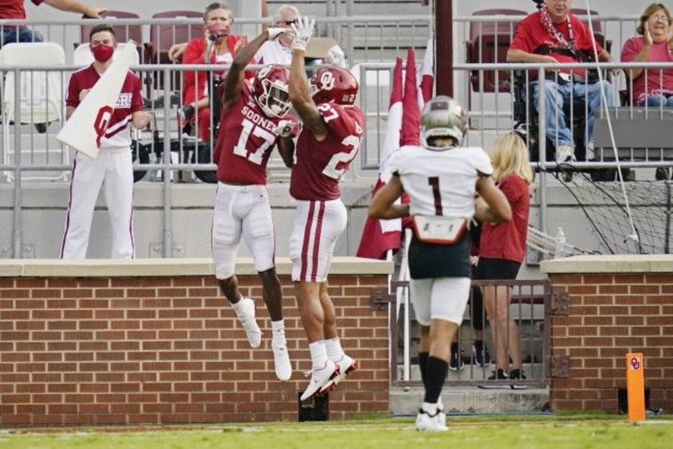 Photo -  OU receiver Marvin Mims (17) celebrates his touchdown with Jeremiah Hall (27) in the first half of the Sooners' 48-0 win over Missouri State on Sept. 12. [AP Photo/Sue Ogrocki]