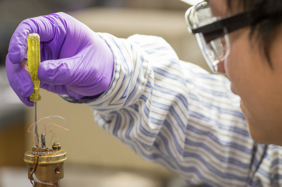 This undated photo released by Michigan State University in East Lansing, Mich., shows doctoral student Xu Lu, who is part of a team that has developed a new thermoelectric material designed to more cheaply capture waste heat energy produced by car engines and industrial processes . Lu is shown working at the university's Center for Revolutionary Materials for Solid State Energy Conversion. (AP Photo/G.L. Kohuth, Michigan State University).