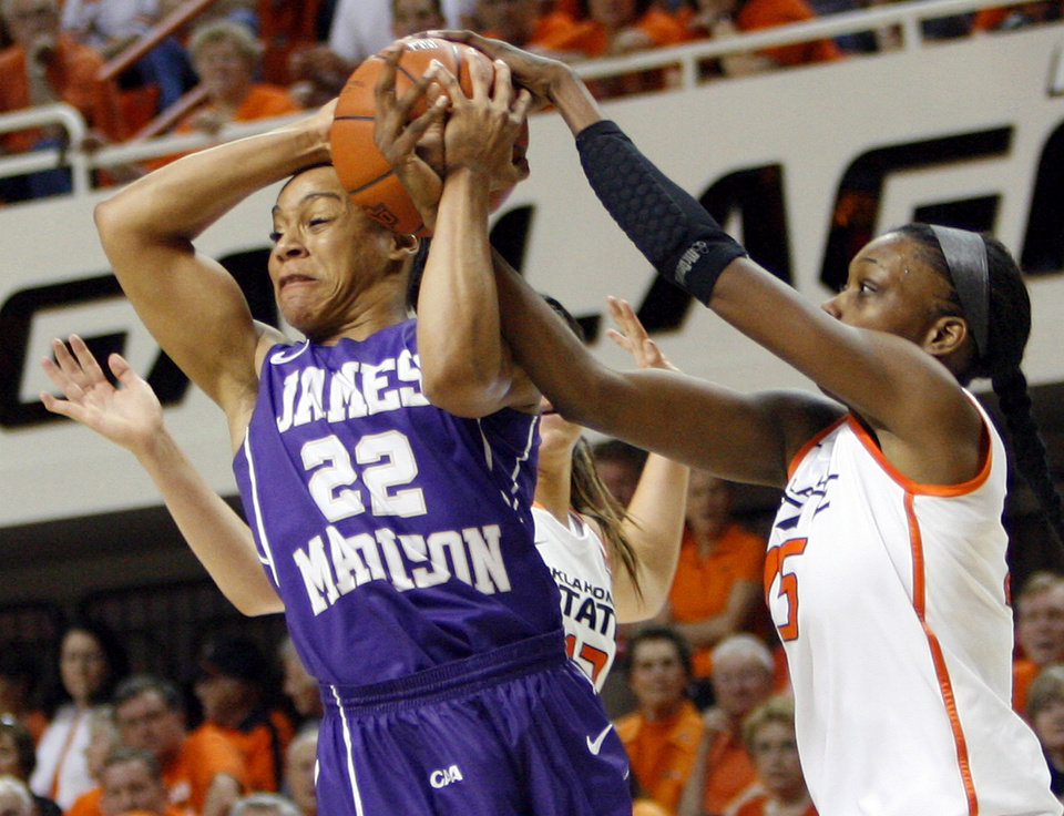 OSU's Toni Young (15) ties up the ball against James Madison's Tarik Hislop (22) during the Women's NIT championship college basketball game between Oklahoma State University and James Madison at Gallagher-Iba Arena in Stillwater, Okla., Saturday, March 31, 2012. Photo by Nate Billings, The Oklahoman