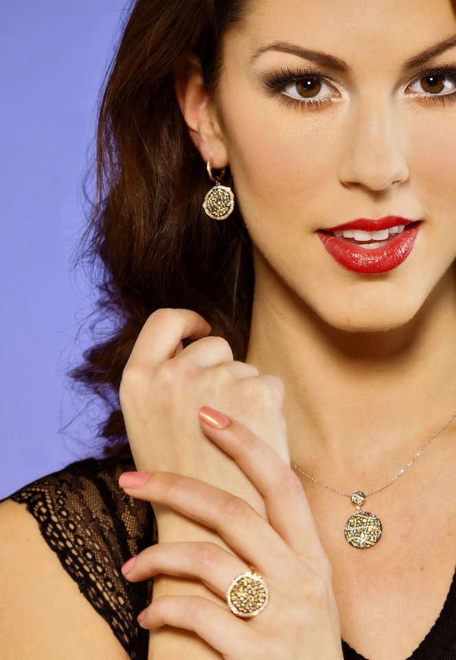 Photo - This pendant features fancy brown, yellow and white diamonds. The dangle earrings and ring feature brown and white diamonds. Sold at Samuel Gordon Jewelers. Model is Alexandra. Makeup by Shellie Pickens for The Makeup Bar.  Photo by Chris Landsberger, The Oklahoman.  CHRIS LANDSBERGER