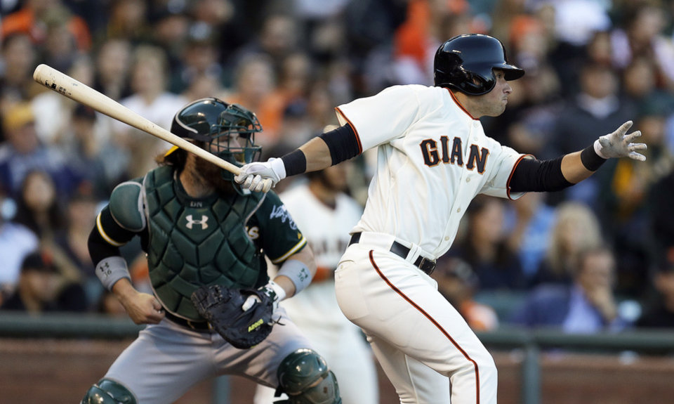 Photo - San Francisco Giants' Joe Panik swings for an RBI single off Oakland Athletics' Jason Hammel in the second inning of a baseball game Wednesday, July 9, 2014, in San Francisco. (AP Photo/Ben Margot)