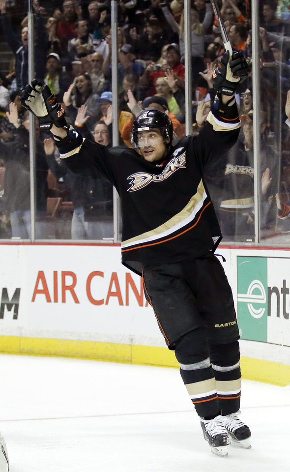 Photo - Anaheim Ducks right wing Teemu Selanne celebrates his goal during the second period of an NHL hockey game against the Colorado Avalanche in Anaheim, Calif., Sunday, Feb. 24, 2013. (AP Photo/Chris Carlson)