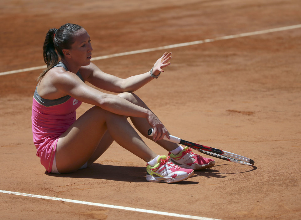 Photo - Serbia's Jelena Jankovic sits on the court after losing a point during her semifinal match against Italy's Sara Errani at the Italian open tennis tournament in Rome, Saturday, May 17, 2014. (AP Photo/Gregorio Borgia)