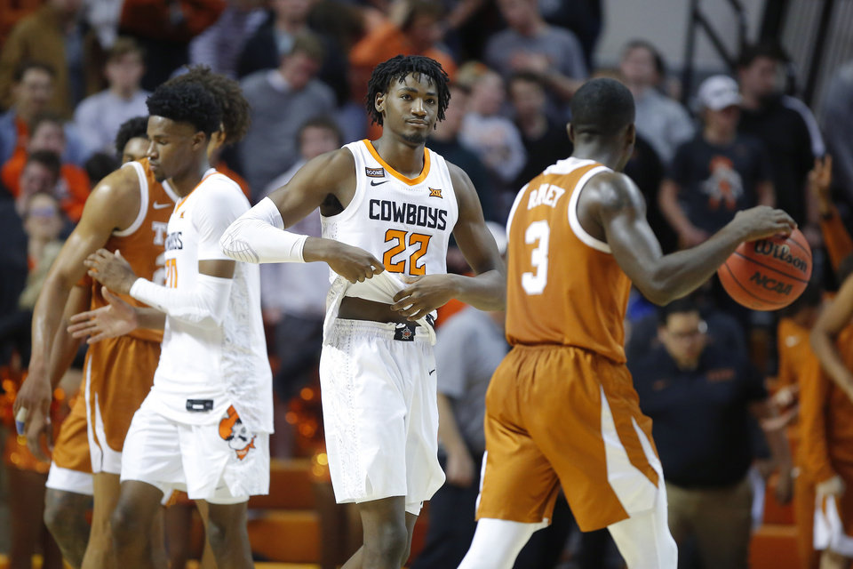 Photo - Oklahoma State's Kalib Boone (22) and Keylan Boone (20) walk off the court as time runs out in an NCAA basketball game between the Oklahoma State University Cowboys (OSU) and the Texas Longhorns at Gallagher-Iba Arena in Stillwater, Okla., Wednesday, Jan. 15, 2020. Oklahoma State lost 76-64. [Bryan Terry/The Oklahoman]
