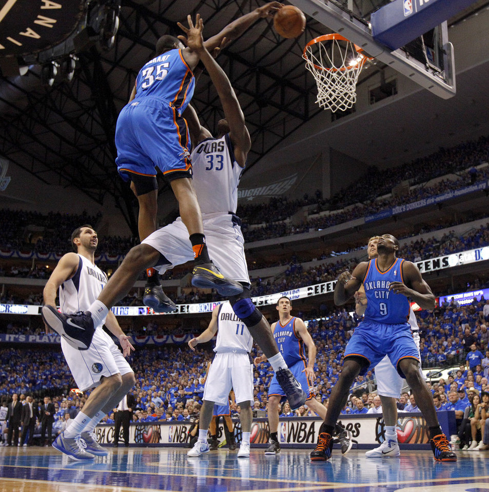 Oklahoma City\'s Kevin Durant (35) dunks the ball over Brendan Haywood (33) of Dallas during game 2 of the Western Conference Finals in the NBA basketball playoffs between the Dallas Mavericks and the Oklahoma City Thunder at American Airlines Center in Dallas, Thursday, May 19, 2011. Photo by Bryan Terry, The Oklahoman