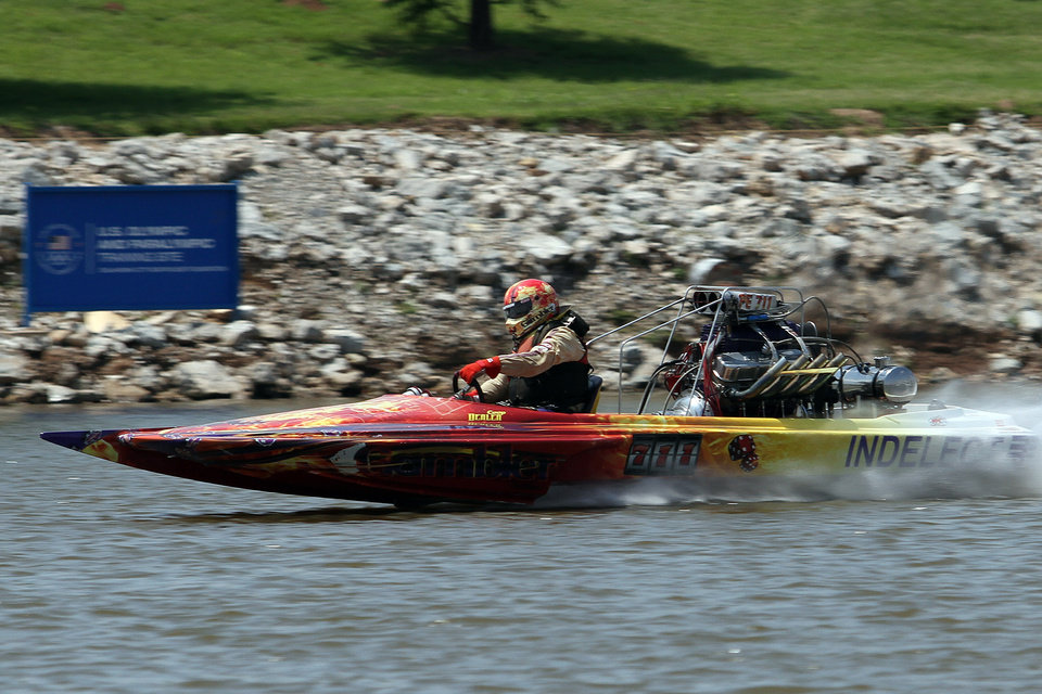 Coop Denlen races down the course during the Oklahoma City Nationals Drag Boat races on the Oklahoma River Saturday, June 9th, 2012. PHOTO BY HUGH SCOTT, FOR THE OKLAHOMAN  ORG XMIT: KOD