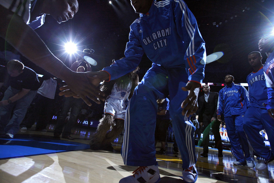 Photo - Oklahoma City's Kendrick Perkins (5) slaps hands with Oklahoma City's Kevin Durant (35) during team introductions during the first round NBA playoff game between the Oklahoma City Thunder and the Denver Nuggets on Sunday, April 17, 2011, in Oklahoma City, Okla. Photo by Chris Landsberger, The Oklahoman