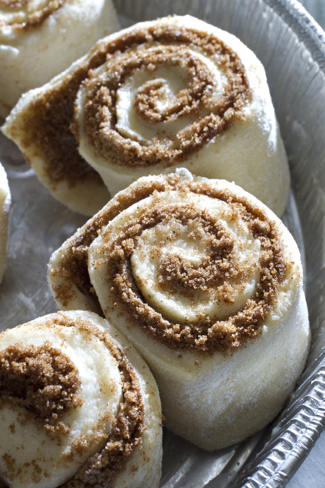 Judith Fertig's Swedish cinnamon rolls rise in the pan before baking. (Tammy Ljungblad/Kansas City Star/MCT)