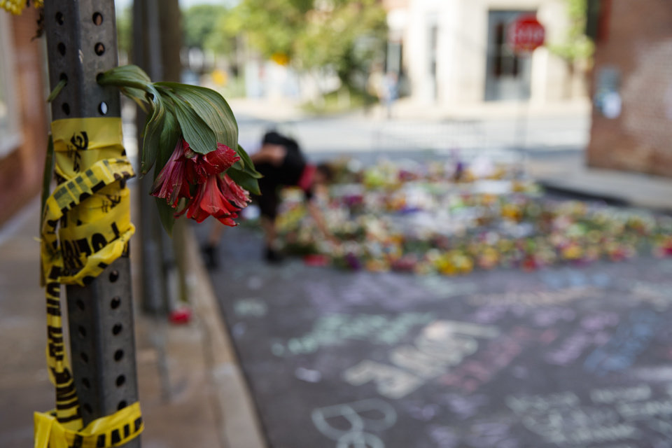 Photo - A flower sits in a pole with police tape at the site where Heather Heyer was killed during a white nationalist rally, Wednesday, Aug. 16, 2017, in Charlottesville, Va. (AP Photo/Evan Vucci)